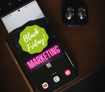 A phone showing the words Black Friday Marketing on it.